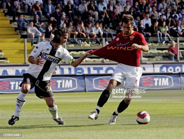 Fernando Couto of Parma Calcio competes for the ball with Mirko Vucinic of AS Roma during the Serie A match between Parma Calcio and AS Roma at...
