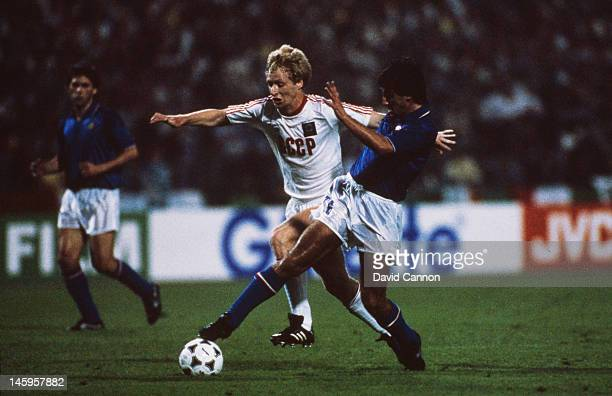 Fernando De Napoli of Italy takes the ball past Oleksiy Mykhailychenko of USSR during the UEFA European Championships 1988 SemiFinals match between...