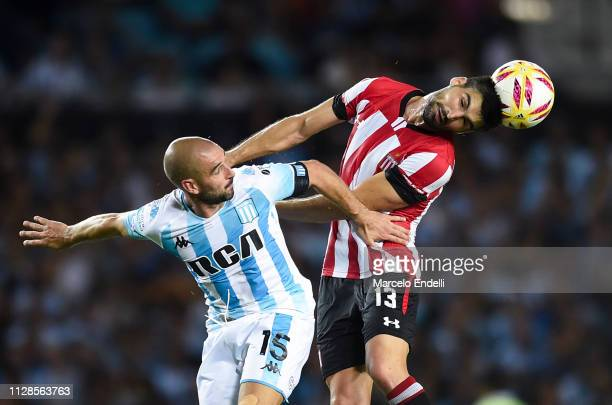 Fernando Evangelista of Estudiantes fights for the ball with Lisandro Lopez of Racing Club during a match between Racing Club and Estudiantes as part...