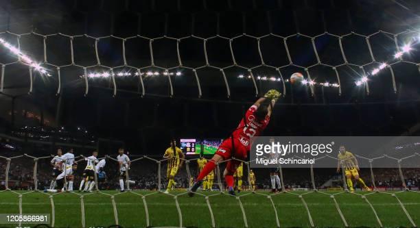 Fernando Fernandez of Guarani PAR scores his team's first goal against Cassio of Corinthians during a match between Corinthians and Guarani PAR as...