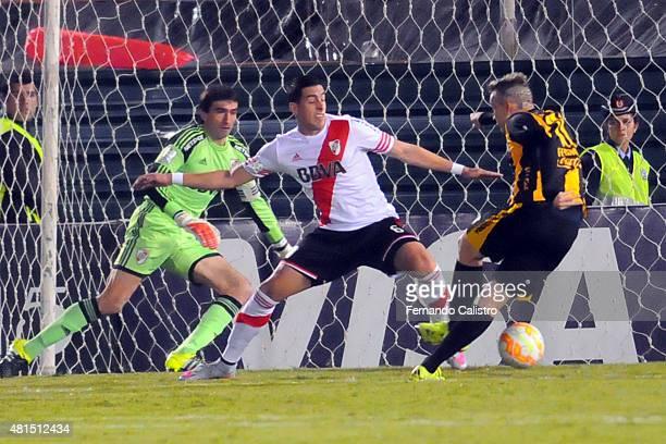 Fernando Fernandez of Guarani shoots to score the opening goal during a second leg Semi Final match between Guarani and River Plate as part of Copa...