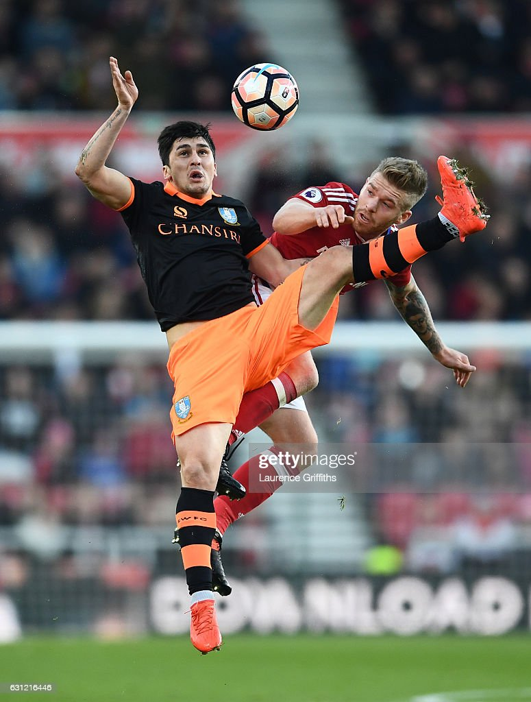 Fernando Forestieri of Sheffield Wednesday (L) and Adam Clayton of Middlesbrough (R) battle to win a header during The Emirates FA Cup Third Round match between Middlesbrough and Sheffield Wednesday at Riverside Stadium on January 8, 2017 in Middlesbrough, England.