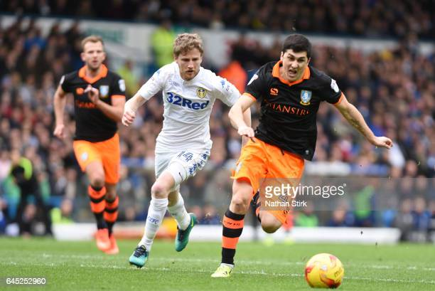 Fernando Forestieri of Sheffield Wednesday and Eunan O'Kane of Leeds United in action during the Sky Bet Championship match between Leeds United and...