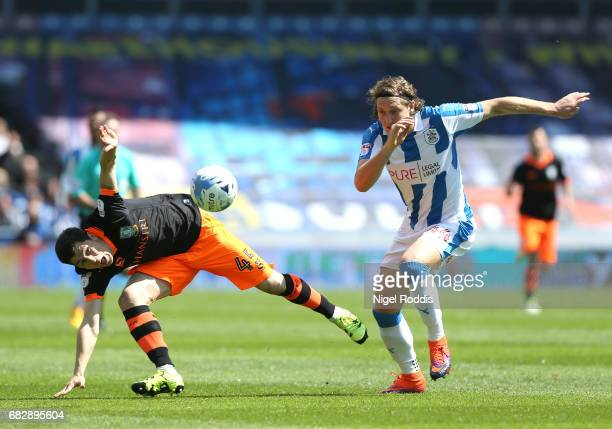 Fernando Forestieri of Sheffield Wednesday and Michael Hefele of Huddersfield Town battle for possession during the Sky Bet Championship Play Off...