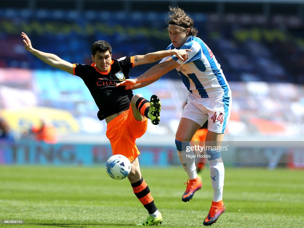 Fernando Forestieri of Sheffield Wednesday and Michael Hefele of Huddersfield Town battle for possession during the Sky Bet Championship Play Off Semi Final 1st leg match between Huddersfield Town and Sheffield Wednesday at Galpharm Stadium on May 14, 2017 in Huddersfield, England.