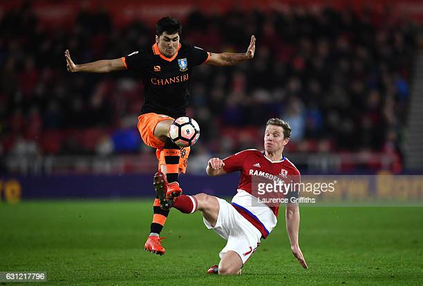 Fernando Forestieri of Sheffield Wednesday attempts to control the ball while under pressure from Grant Leadbitter of Middlesbrough during The...