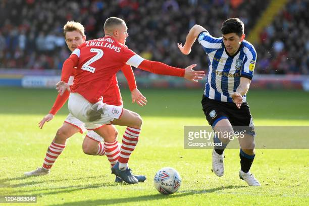 Fernando Forestieri of Sheffield Wednesday gets away from Jordan Williams of Barnsley during the Sky Bet Championship match between Barnsley and...