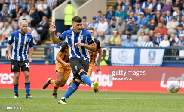 Fernando Forestieri of Sheffield Wednesday scores a goal from a penalty to make the score 11 during the Sky Bet Championship between Sheffield...