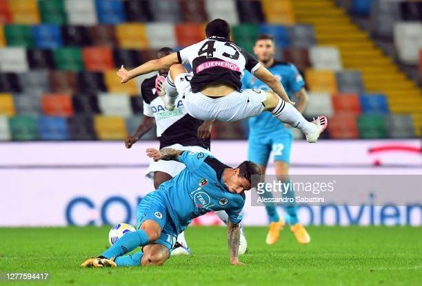 Fernando Forestieri of Udinese Calcio competes for the ball with Paolo Bartolomei of Spezia Calcio during the Serie A match between Udinese Calcio...