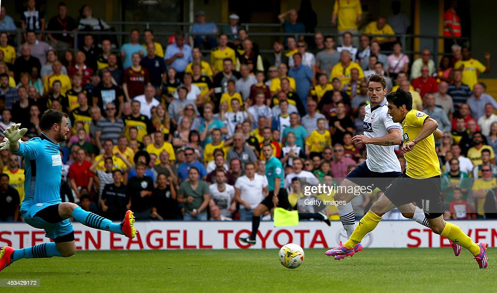 Fernando Forestieri of Watford slots the ball past Andy Lonergan goalkeeper for Bolton Wanderers to score the third goal during the Sky Bet Championship match between Watford and Bolton Wanderers at Vicarage Road on August 9, 2014 in Watford, England.