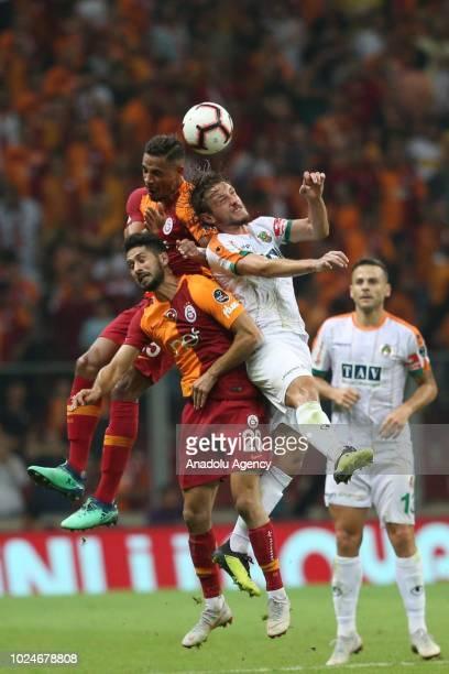 Fernando Francisco Reges and Emre Akbaba of Galatasaray in action against Taha Yalciner of Aytemiz Alanyaspor during Turkish Super Lig soccer match...