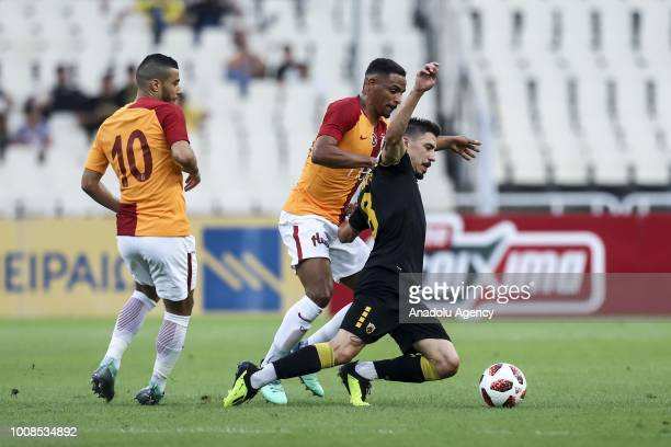 Fernando Francisco Reges and Younes Belhanda of Galatasaray in action with Andre Simoes of AEK Athens during friendly football game between AEK...