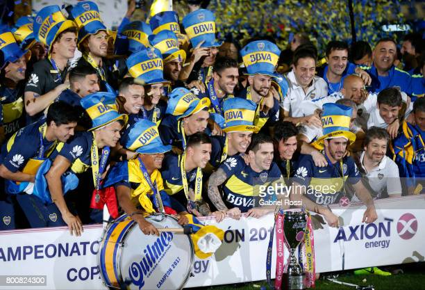 Fernando Gago Dario Benedetto Pablo Perez and Cristian Pavon of Boca Juniors celebrate with the champions trophy after a match between Boca Juniors...