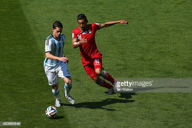 Fernando Gago of Argentina controls the ball against Reza Ghoochannejhad of Iran during the 2014 FIFA World Cup Brazil Group F match between...