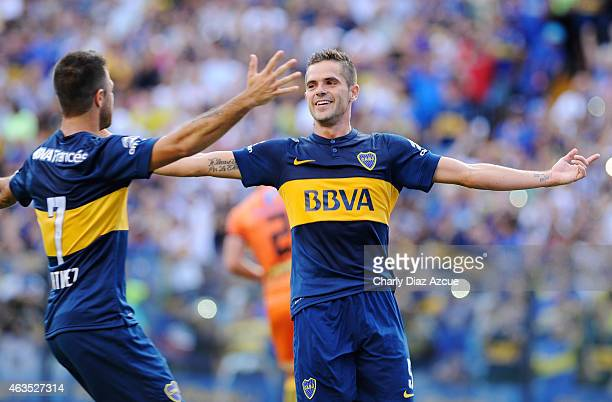Fernando Gago of Boca Juniors celebrates with his teammate after scoring the first goal of his team against Olimpo during a match between Boca...