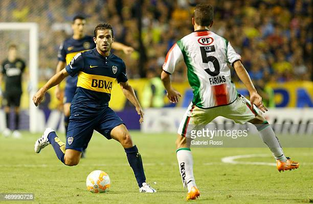Fernando Gago of Boca Juniors fights for the ball with Agustin Farias of Palestino during a match between Boca Juniors and Palestino as part of Group...