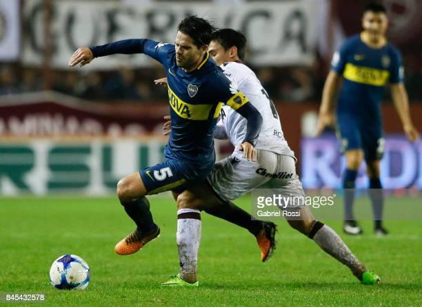 Fernando Gago of Boca Juniors fights for the ball with Matias Rojas of Lanus during a match between Lanus and Boca Juniors as part of the Superliga...