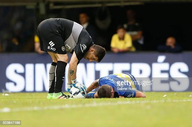 Fernando Gago of Boca Juniors lies injured as Agustin Orion assits him during a match between Boca Juniors and River Plate as part of Torneo...