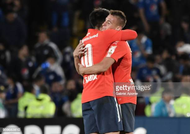 Fernando Gaibor and Braian Romero of Independiente celebrate after a match between Millonarios and Independiente as part of Copa CONMEBOL...