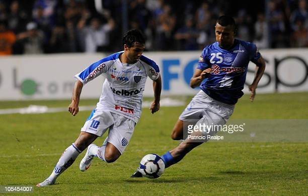 Fernando Gaibor of Ecuador's Emelec vies for the ball with Marquinhos Santos of Brazil's Avai during a 2010 Copa Nissan Sudamericana match at the...
