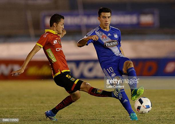 Fernando Gaibor of Emelec fights for the ball with Cristian Ona of Deportivo Cuenca during a match between Emelec and Deportivo Cuenca as part of...