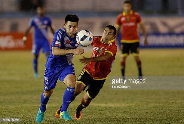 Fernando Gaibor of Emelec fights for the ball with Ronaldo Johnson of Deportivo Cuenca during a match between Emelec and Deportivo Cuenca as part of...