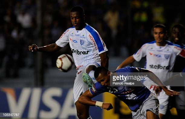 Fernando Gaibor of Emelec struggles for the ball with Marquinhos Santos of Avai during a match as part of the 2010 Copa Nissan Sudamericana at the...