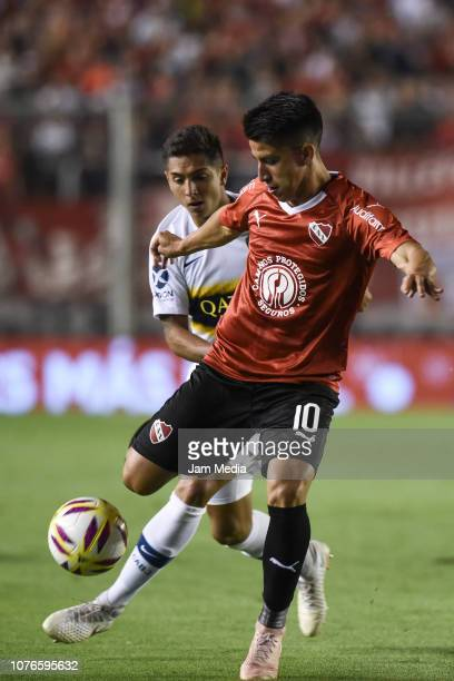Fernando Gaibor of Independiente fights for the ball with Agustin Almendra of Boca Juniors during a match between Independiente and Boca Juniors as...