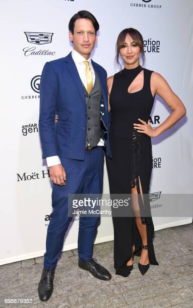 Fernando Garcia and Jackie Cruz attends the amfAR generationCURE Solstice 2017 at Mr Purple on June 20 2017 in New York City