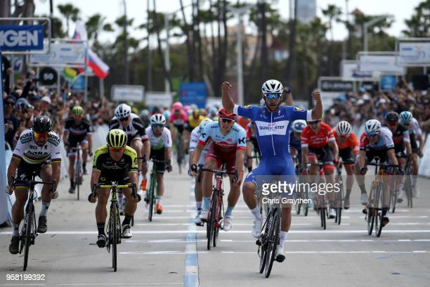 Fernando Gaviria of Colombia and Team Quick-Step Floors celebrates alongside Peter Sagan of Slovakia and Team Bora - Hansgrohe and Caleb Ewan of...