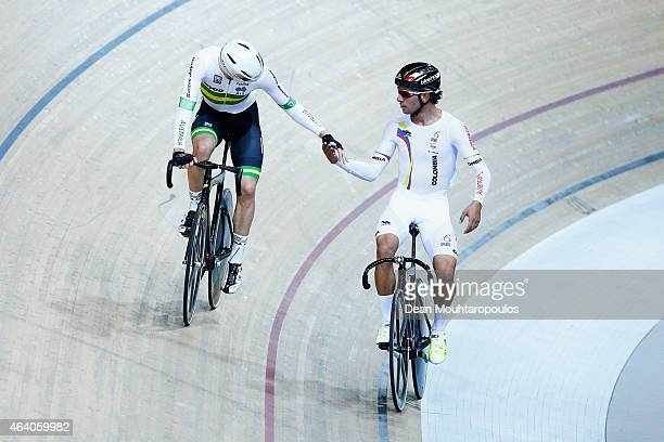 Fernando Gaviria of Colombia celebrates winning the gold medal in the Men's Omnium and shakes hands with silver medal winner Glenn O'Shea of...
