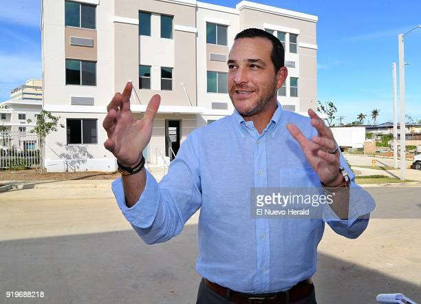 Fernando Gil Puerto Rico's Housing Department Secretary during a visit to 'Las Gladiolas' a new government housing project in San Juan on November 30...