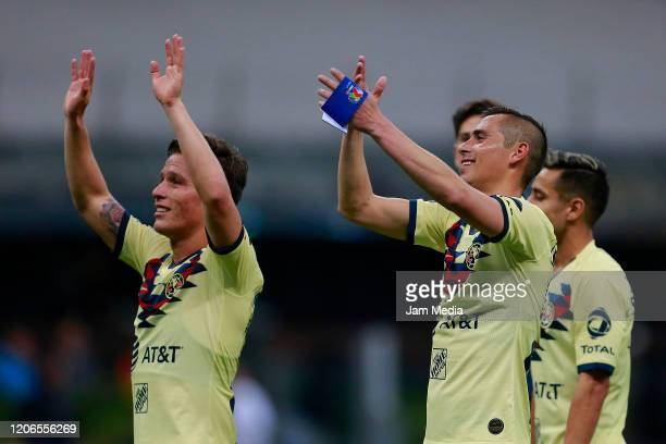 Fernando Gonzalez and Paul Aguilar of America celebrate after the 6th round match between America and Atlas as part of the Torneo Clausura 2020 Liga...