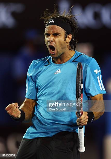Fernando Gonzalez of Chile celebrates winning a point in his fourth round match against Andy Roddick of the United States of America during day seven...
