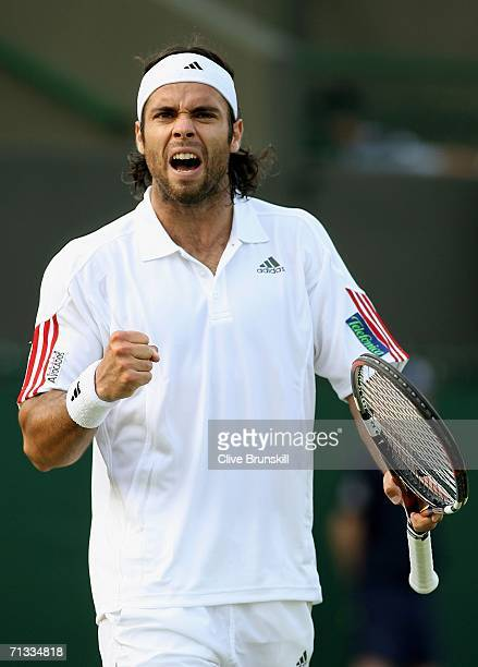 Fernando Gonzalez of Chile celebrates winning match point against Marat Safin of Russia during day four of the Wimbledon Lawn Tennis Championships at...