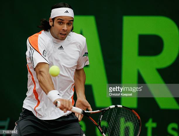 Fernando Gonzalez of Chile in action against David Ferrer of Spain in the match between Spain and Chile during Day 1 of the ARAG World Team Cup at...