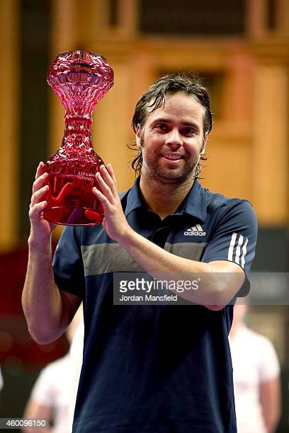 Fernando Gonzalez of Chile lifts the trophy after winning the ATP Champions Tour Final match against Andy Roddick of the USA during day five of the...