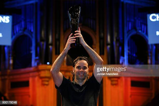 Fernando Gonzalez of Chile lifts the trophy after winning the ATP Champions Tennis Final match against Tim Henman of Great Britain during day five of...