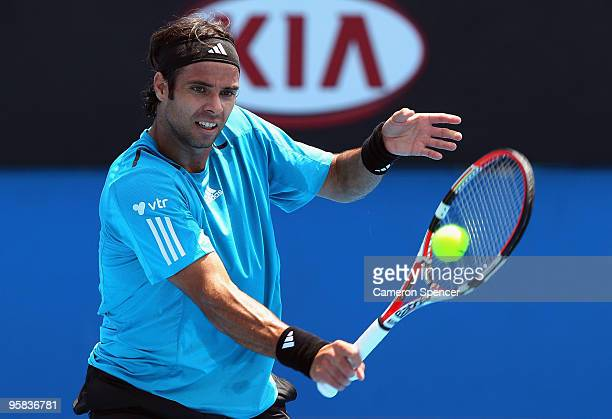 Fernando Gonzalez of Chile plays a backhand in his first round match against Olivier Rochus of Belgium during day one of the 2010 Australian Open at...