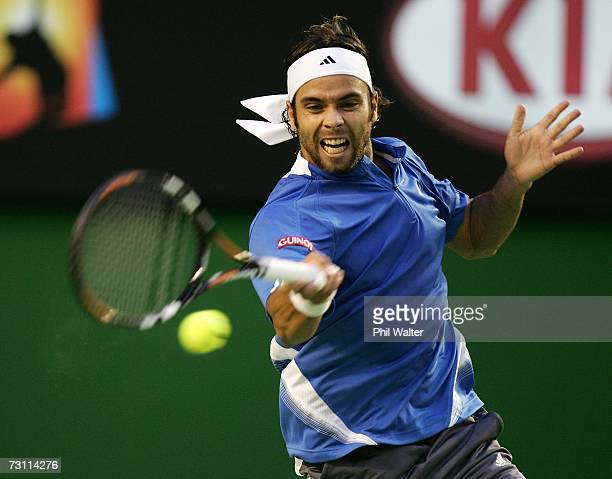 Fernando Gonzalez of Chile plays a forehand during his semi-final match against Tommy Haas of Germany on day twelve of the Australian Open 2007 at...