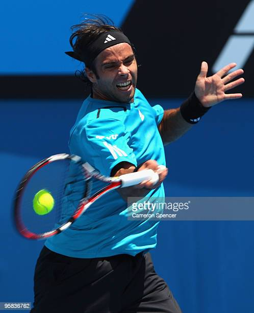 Fernando Gonzalez of Chile plays a forehand in his first round match against Olivier Rochus of Belgium during day one of the 2010 Australian Open at...