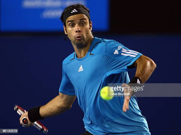 Fernando Gonzalez of Chile plays a forehand in his fourth round match against Andy Roddick of the United States of America during day seven of the...