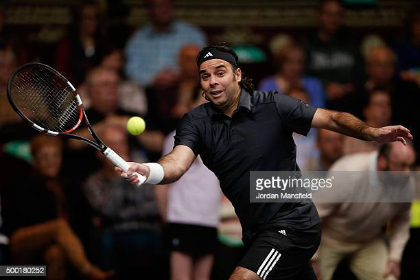 Fernando Gonzalez of Chile reaches for a forehand in the ATP Champions Tennis Final match against Tim Henman of Great Britain during day five of the...