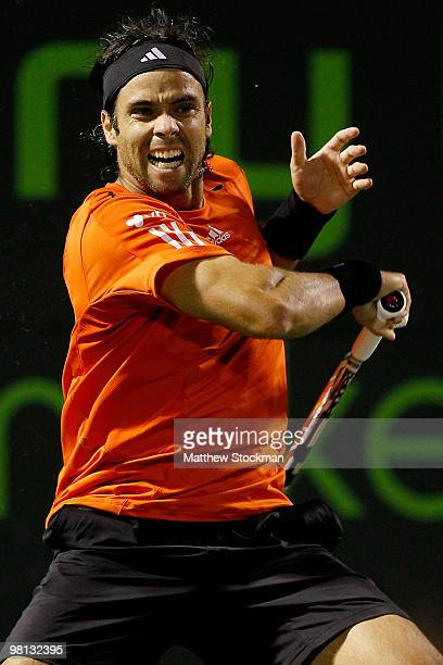 Fernando Gonzalez of Chile returns a shot to Juan Monaco of Argentina during day seven of the 2010 Sony Ericsson Open at Crandon Park Tennis Center...