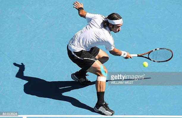 Fernando Gonzalez of Chile returns the ball in his game against Rafael Nadal of Spain during their men's tennis match on day eight of the Australian...