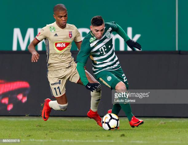 Fernando Gorriaran of Ferencvarosi TC competes for the ball with Loic Nego of Videoton FC during the Hungarian OTP Bank Liga match between...