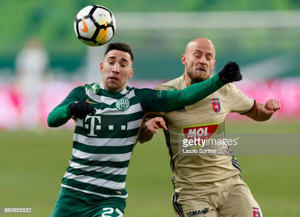 Fernando Gorriaran of Ferencvarosi TC competes for the ball with Jozsef Varga of Videoton FC during the Hungarian OTP Bank Liga match between...