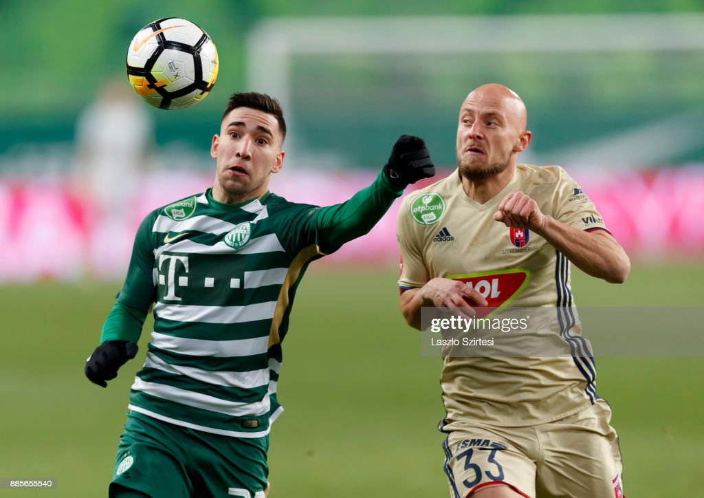 Fernando Gorriaran (L) of Ferencvarosi TC competes for the ball with Jozsef Varga #33 of Videoton FC during the Hungarian OTP Bank Liga match between Ferencvarosi TC and Videoton FC at Groupama Arena on December 2, 2017 in Budapest, Hungary.