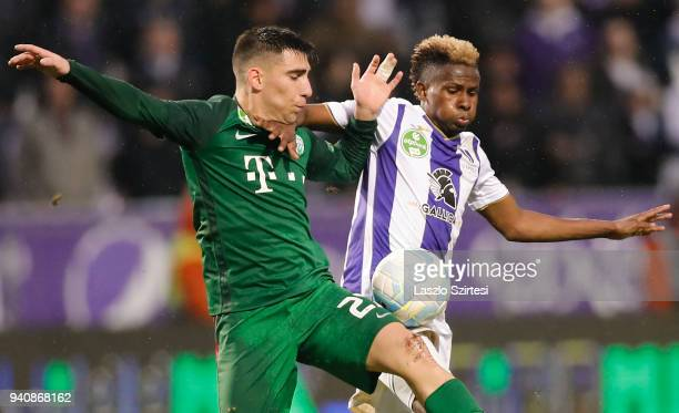 Fernando Gorriaran of Ferencvarosi TC competes for the ball with Alassane Diallo of Ujpest FC during the Hungarian OTP Bank Liga match between Ujpest...