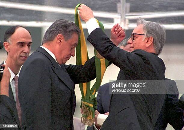 Fernando Henrique Cardoso receives the presidential sash of office 01 January 1995 from outgoing President Itamar Franco at the Planalto Palace in...